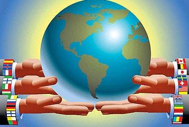International Hands Holding Globe --- Image by © Images.com/Corbis
