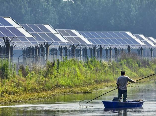 Southeast Asia Market Analysis man on boat solar panels